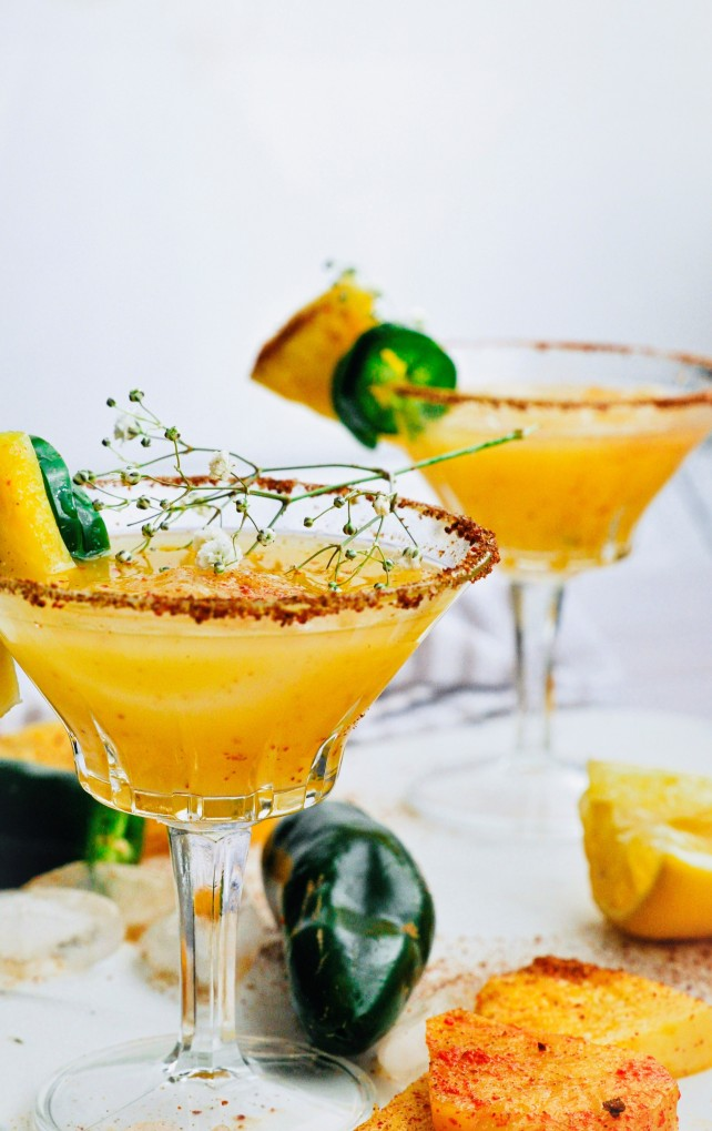This grilled pineapple jalapeno mocktail is a sweet and refreshing tropical island inspired beverage and it's so fresh and so refreshing, it's like sunshine in a glass.