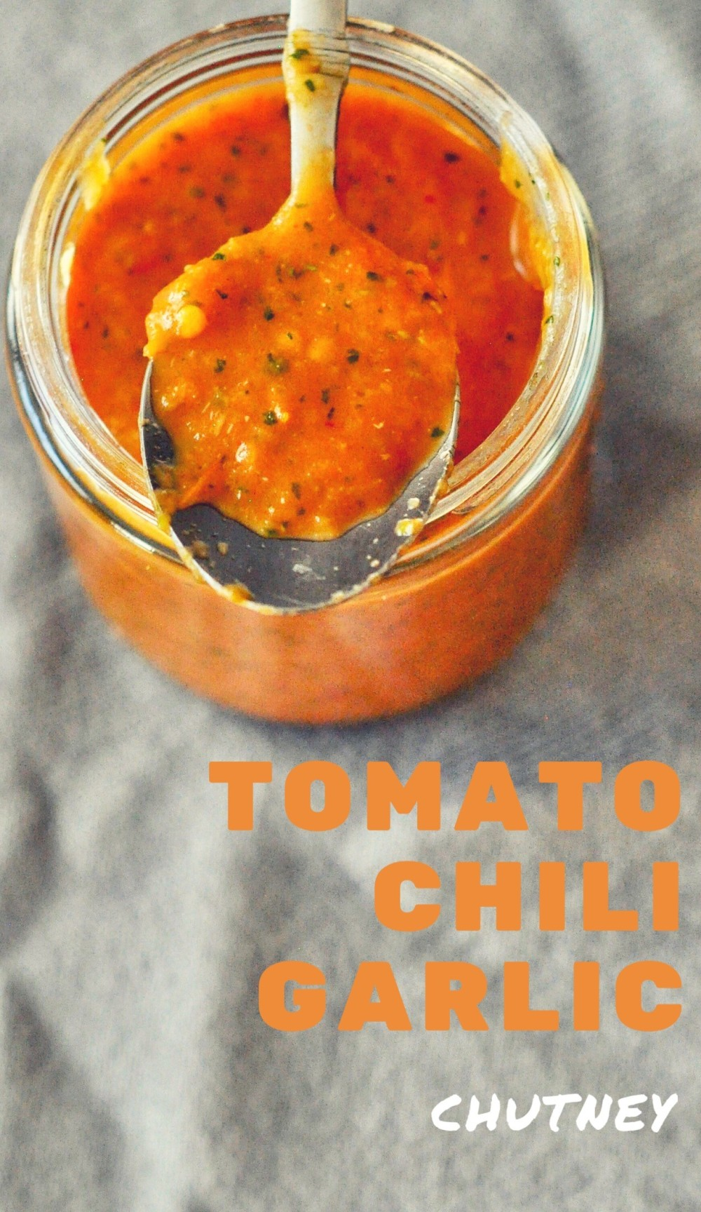 This tomato chili garlic chutney is packed with flavors. Slather it on toasts or cheese or crackers or even use as a spread for sandwiches. It would also make a great edible gift with homemade bread or crackers.