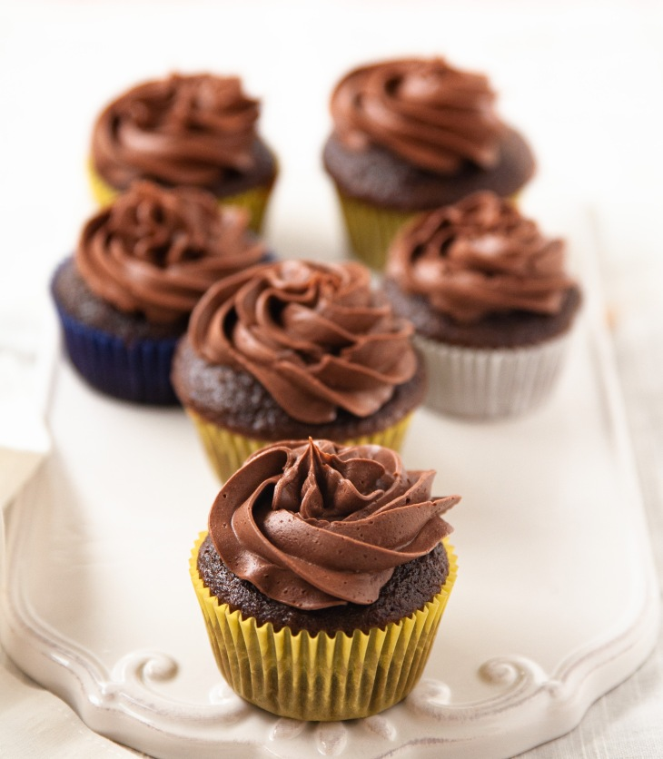 These Fudgy Chocolate Cupcakes are moist, fudgy and full of chocolate flavor! They literally melt in your mouth and is a party favorite. Bake these chocolate cupcakes for Birthday parties, baby showers or any special occasions and see them getting disappeared in a jiffy.